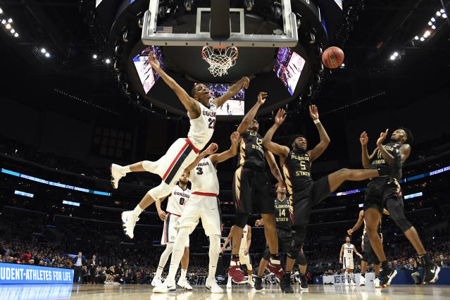 <p>Zach Norvell #23 of the Gonzaga Bulldogs loses possession of the ball against the Florida State Seminoles during the third round of the 2018 NCAA Men's Basketball Tournament held at Staples Center on March 22, 2018 in Los Angeles, California. (Photo by Jamie Schwaberow/NCAA Photos via Getty Images) </p>