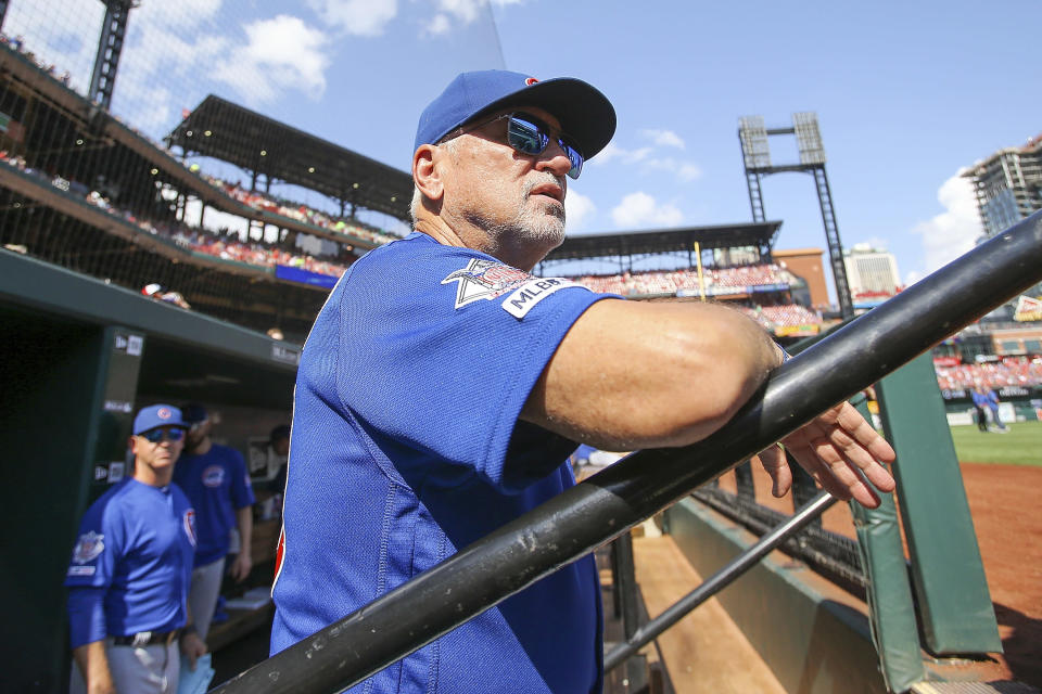 Chicago Cubs manager Joe Maddon looks out from the dugout prior to a baseball game against the St. Louis Cardinals, Sunday, Sept. 29, 2019, in St. Louis. (AP Photo/Scott Kane)