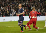 PSG's Lionel Messi reacts after missing a chance during the French League One soccer match between Paris Saint-Germain and Lyon at the Parc des Princes in Paris Sunday, Sept. 19, 2021. (AP Photo/Francois Mori)