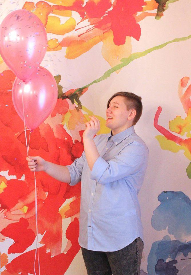 Adrian popped pink balloons to reveal blue confetti. Photo: Supplied/Facebook/HeatherLundbergGreen
