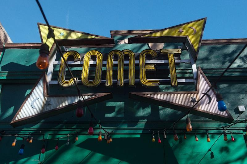 The sign for the Comet Ping Pong restaurant is seen in Washingon, DC, on December 5, 2016