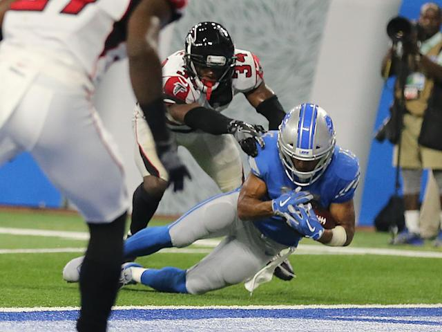 Golden Tate falls agonisingly short of the end zone to hand the Atlanta Falcons victory against the Detroit Lions: Getty