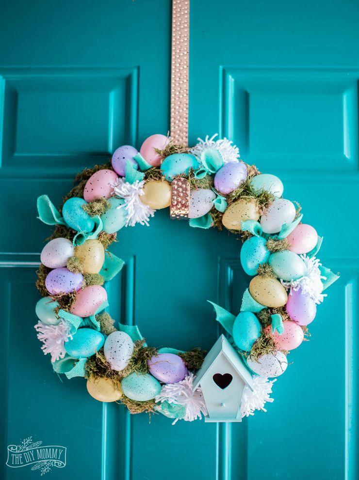 """<p>Capture the sweetness of Easter with this pastel-inspired wreath. It features plastic speckled eggs and a miniature birdhouse. </p><p><strong>Get the tutorial at <a href=""""https://thediymommy.com/make-a-dollar-store-easter-egg-wreath-so-cute-easy/"""" rel=""""nofollow noopener"""" target=""""_blank"""" data-ylk=""""slk:The DIY Mommy"""" class=""""link rapid-noclick-resp"""">The DIY Mommy</a>.</strong></p><p><a class=""""link rapid-noclick-resp"""" href=""""https://go.redirectingat.com?id=74968X1596630&url=https%3A%2F%2Fwww.walmart.com%2Fip%2FMini-Decorative-Speckled-Eggs-Robin-36-Piece%2F504218391&sref=https%3A%2F%2Fwww.thepioneerwoman.com%2Fhome-lifestyle%2Fcrafts-diy%2Fg35698457%2Fdiy-easter-wreath-ideas%2F"""" rel=""""nofollow noopener"""" target=""""_blank"""" data-ylk=""""slk:SHOP SPECKLED EGGS"""">SHOP SPECKLED EGGS</a></p>"""