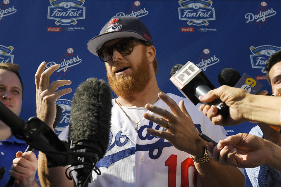 FILE - Los Angeles Dodgers' Justin Turner is interviewed by reporters during Dodger Stadium FanFest in Los Angeles, in this Saturday, Jan. 25, 2020, file photo. Justin Turner's extended flirtation with free agency ended where it began — with the Los Angeles Dodgers. Along the way, the third baseman had doubts about whether he would return to his hometown team and wondered if his mask-less appearance on the field to celebrate its World Series championship would hurt him. (AP Photo/Mark J. Terrill, File)