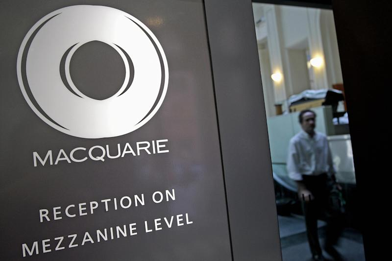 A man walks inside Macquarie office building in Sydney on February 6, 2008. The head of Australia's Macquarie Bank said on February 6, the bank expected a record profit of at least 1.8 billion dollars (1.6 billion USD) for the year to March, despite a weaker second half. AFP PHOTO/Anoek DE GROOT (Photo credit should read ANOEK DE GROOT/AFP via Getty Images)