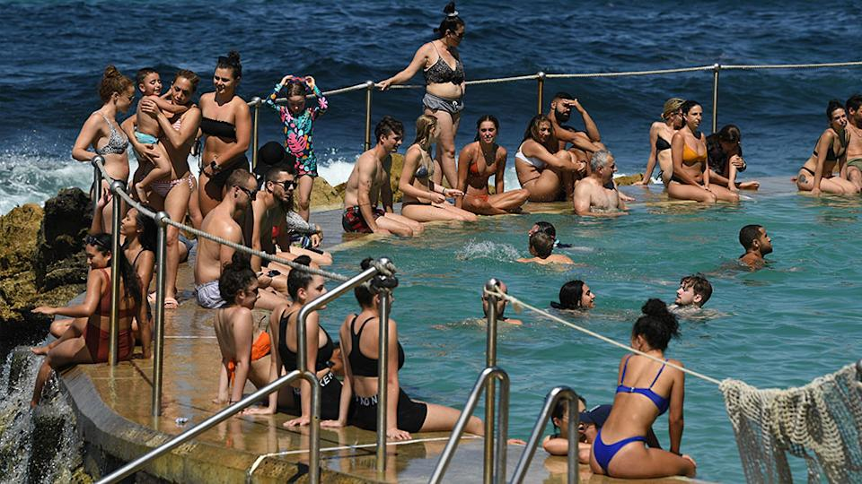Crowds flocked to Bondi Beach for a swim on Saturday during the heatwave.