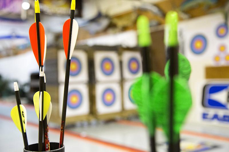 "In this April 13, 2012 photo, targets and arrows are seen during the youth archery league match at Targeteers Archery in Saddle Brook, N.J.  In schools and backyards, for their birthdays and out with their dads, kids are gaga for archery a month after the release of ""The Hunger Games."" Archery ranges around the country have enjoyed a steady uptick among kids of both sexes in the movie's lead-up, though 16-year-old heroine Katniss Everdeen, the archery ace seems to resonate with girls more than boys. (AP Photo/Charles Sykes)"