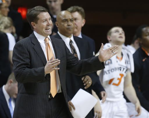 Oklahoma State head coach Travis Ford gestures during a time out in the second half of an NCAA college basketball game against Kansas State in Stillwater, Okla., Saturday, March 9, 2013. Oklahoma State won 76-70. (AP Photo/Sue Ogrocki)