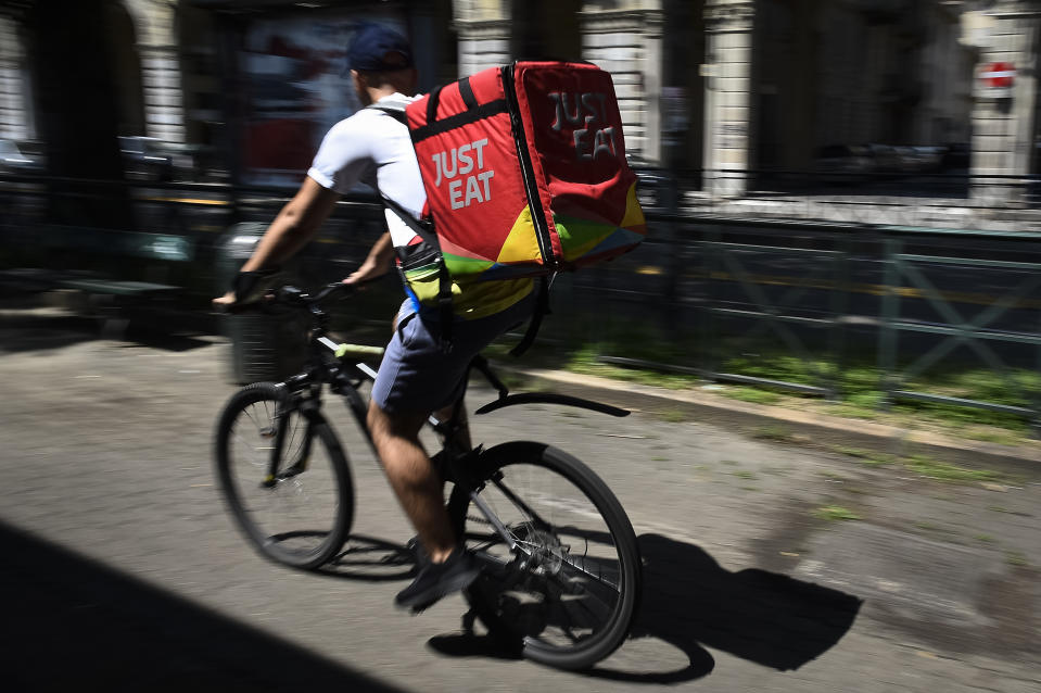 VIA SACCHI, TURIN, ITALY - 2019/08/02: A Just Eat courier rides during his work. Just Eat is a online food delivery app (as Glovo, Uber Eats and Foodora) that hires food riders as independent contractors. (Photo by Nicolò Campo/LightRocket via Getty Images)