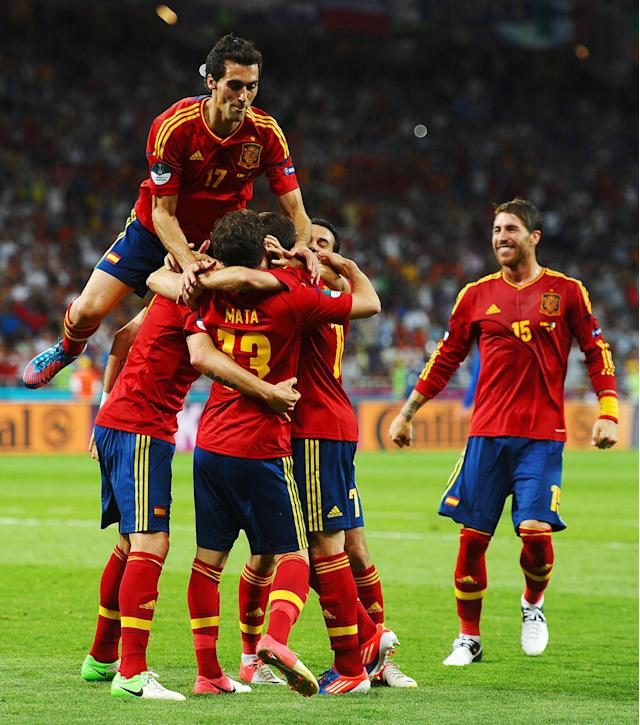 KIEV, UKRAINE - JULY 01: Alvaro Arbeloa of Spain leaps on his team-mates as they celebrate after Juan Mata scored their fourth goal during the UEFA EURO 2012 final match between Spain and Italy at the Olympic Stadium on July 1, 2012 in Kiev, Ukraine. (Photo by Laurence Griffiths/Getty Images)