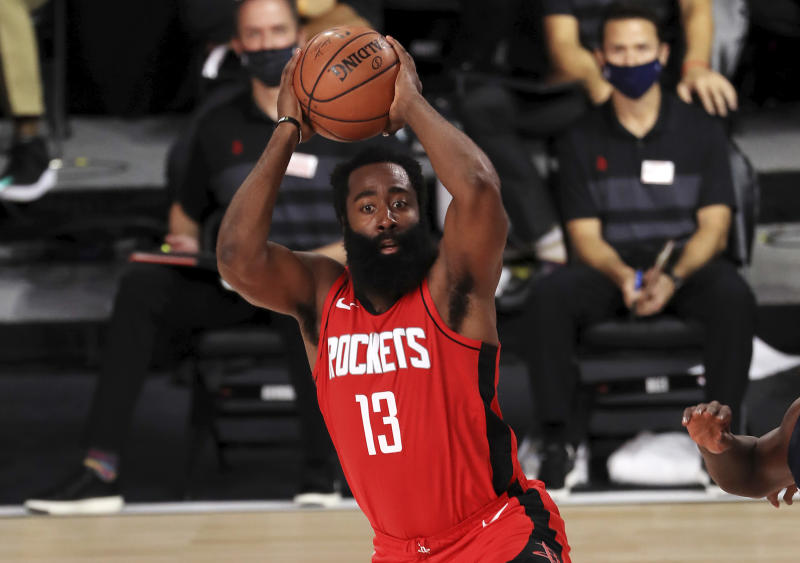 Houston Rockets James Harden (13) handles the ball against the Dallas Maverick during the first half of an NBA basketball game Friday, July 31, 2020, in Lake Buena Vista, Fla. (Mike Ehrmann/Pool Photo via AP)