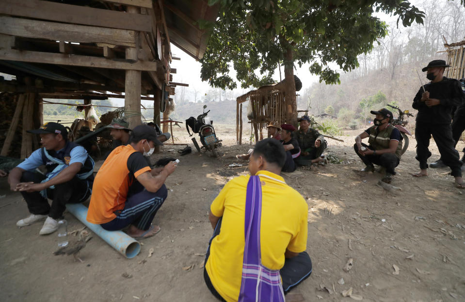 Thai villagers visit at a checkpoint of the Thai Rangers in Mae Sakoep village in Mae Hong Son province, Thailand, Monday, March 29, 2021, where people from neighboring Myanmar arrived after they had fled from their homes, following airstrikes by Myanmar's military. (AP Photo/Sakchai Lalit)