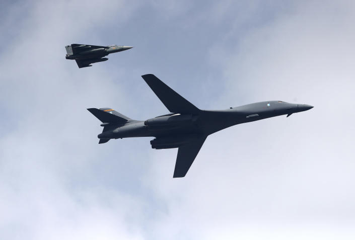 A U.S. Air Force B-1B Lancer bomber, right, flies with an Indian Air Force light combat aircraft Tejas on the inaugural day of Aero India 2021 at Yelahanka air base in Bengaluru, India, Wednesday, Feb. 3, 2021. India has high hopes its ties with the United States will deepen under President Joe Biden, who was a key proponent of the 2008 civil nuclear deal between the countries and whose new administration includes several Indian Americans. (AP Photo/Aijaz Rahi)