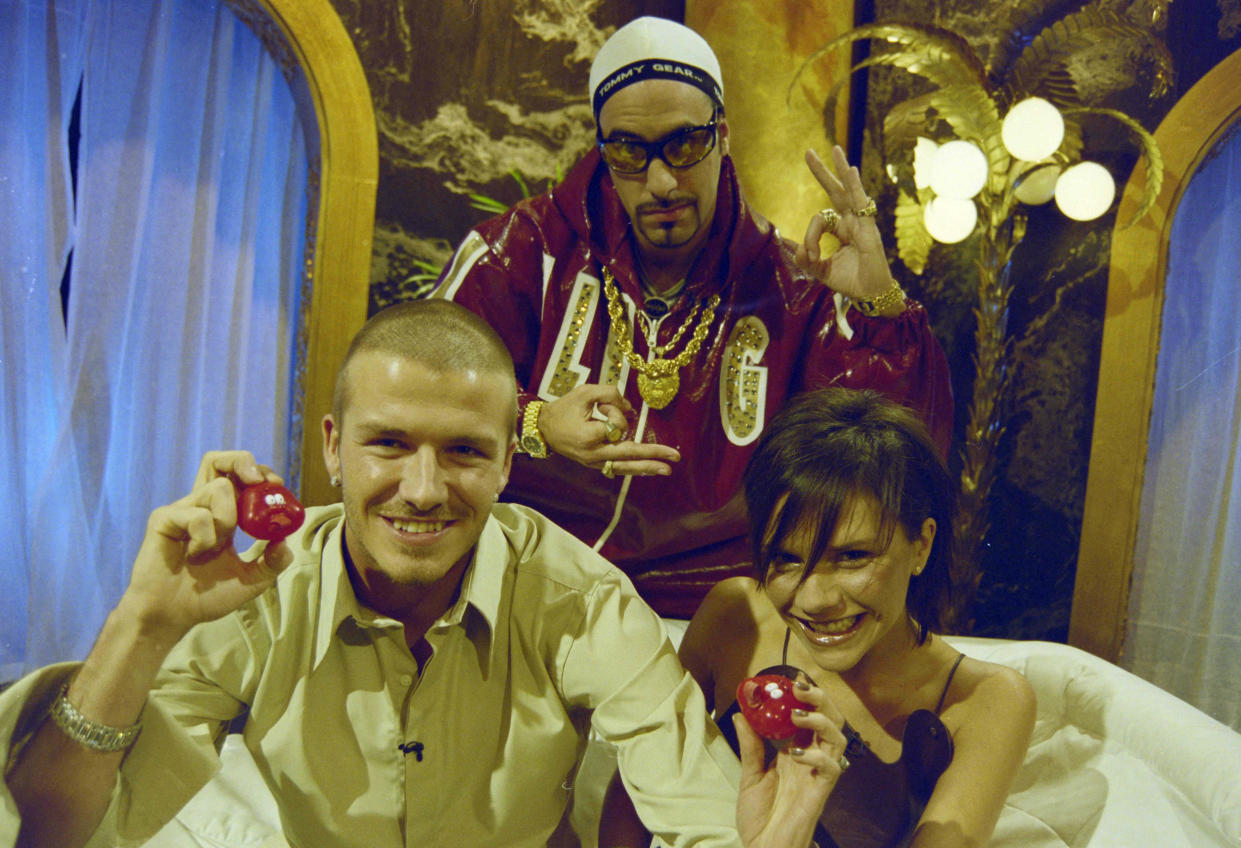 LONDON, ENGLAND: David Beckham and Victoria Beckham show off the nose of Red Nose Day 2001 while filming for their interview with Ali G (Sacha Baron Cohen) that was shown on the Night of TV Broadcast. (Photo by Comic Relief/Comic Relief via Getty Images)