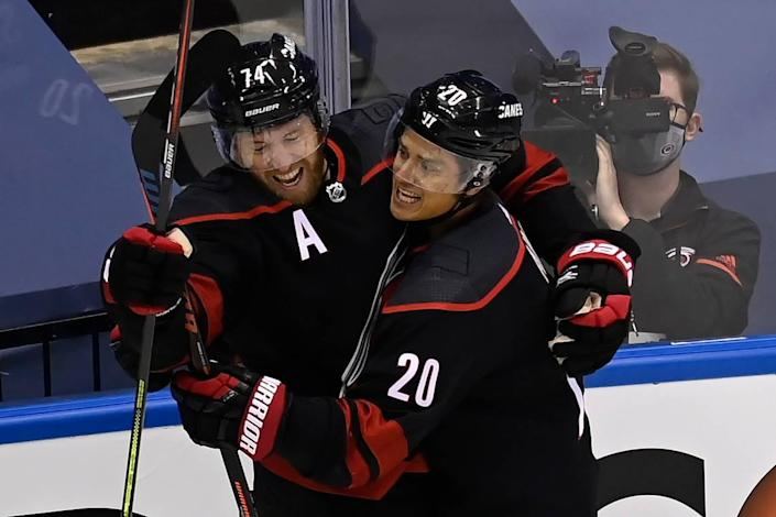 Carolina Hurricanes defenceman Jaccob Slavin (74) celebrates his goal against the New York Rangers with teammate Sebastian Aho (20) during the first period in the NHL hockey Stanley Cup playoffs in Toronto, Saturday, Aug. 1, 2020.