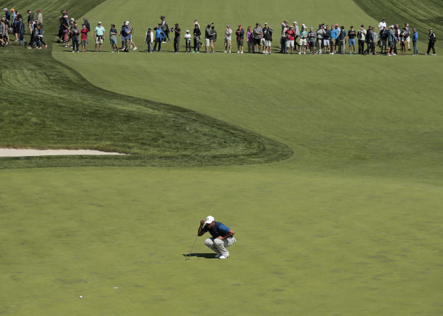 Tiger Woods lines up a putt on the 16th green during the first round of the PGA Championship golf tournament, Thursday, May 16, 2019, at Bethpage Black in Farmingdale, N.Y. (AP Photo/Andres Kudacki)