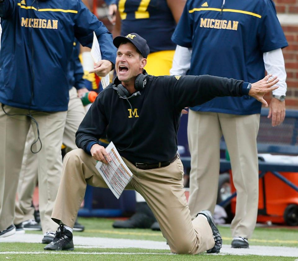 Michigan head coach Jim Harbaugh arguing a roughing the punter penalty late in the second quarter against Oregon State at Michigan Stadium on Saturday, Sept. 12, 2015, in Ann Arbor.