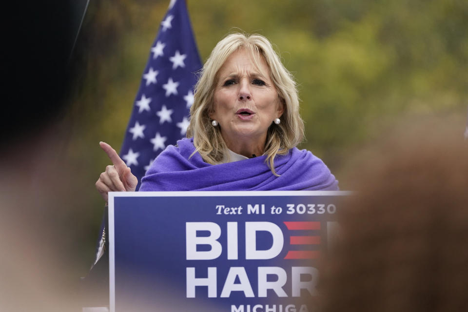 Jill Biden speaks to supporters while campaigning for her husband Democratic presidential candidate former Vice President Joe Biden, Thursday, Oct. 29, 2020, in Westland, Mich. (AP Photo/Carlos Osorio)