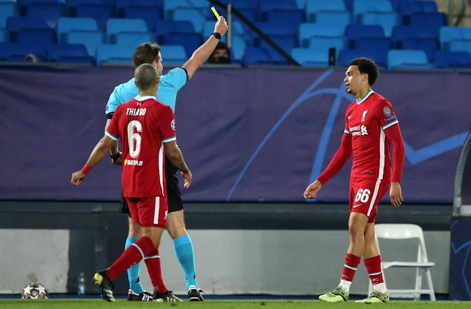 Trent Alexander-Arnold (right) is booked during Liverpool's 3-1 defeat at Real Madrid in their Champions League quarter-final first leg.