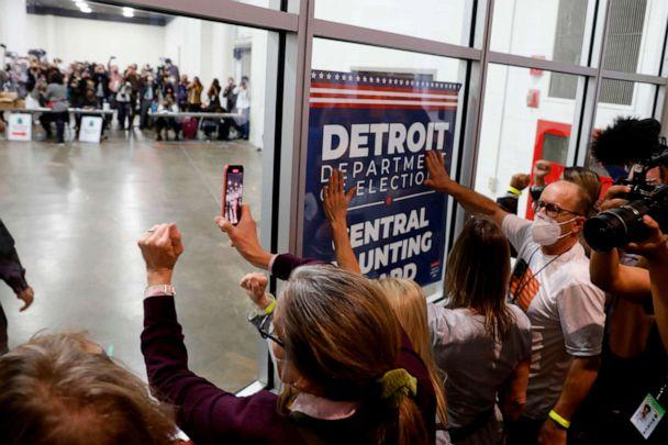 PHOTO: Supporters of President Donald Trump bang on the glass and chant slogans outside the room where absentee ballots for the 2020 general election are being counted at TCF Center on Nov. 4, 2020, in Detroit, Mich. (Jeff Kowalsky/AFP via Getty Images)