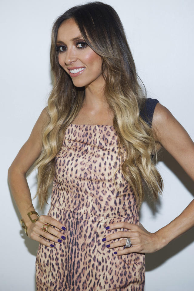 """FILE - In a Monday, Sept. 12, 2011 file photo, """"E! News"""" co-host Giuliana Rancic attends the Rachel Zoe Spring 2012 fashion show during Mercedes-Benz Fashion Week in New York. Rancic says she has early stages of breast cancer. The 37-year-old made the announcement Monday, Oct. 16, 2011 on NBC's """"Today"""" show. (AP Photo/Charles Sykes, File)"""