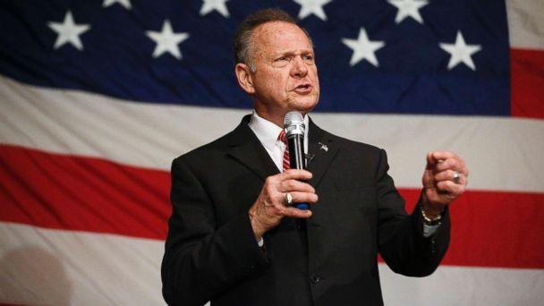 Roy Moore supporters call added text to accuser's yearbook a 'forgery'