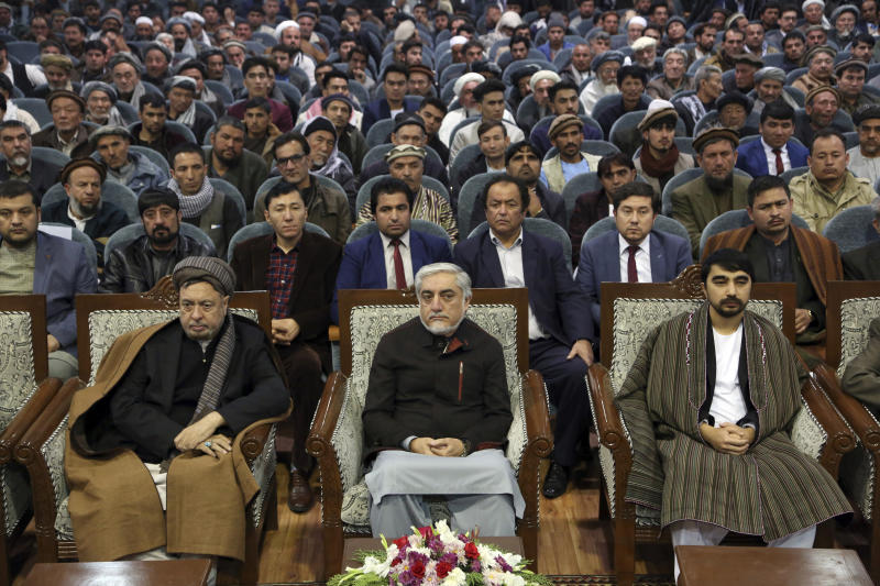 Afghan presidential candidate Abdullah Abdullah, front center, attends at a gathering in Kabul, Afghanistan, Sunday, Nov. 10, 2019. Abdullah has unilaterally withdrawn his team's election observers from an official recount of ballots ahead of long-delayed election results. (AP Photo/Rahmat Gul)