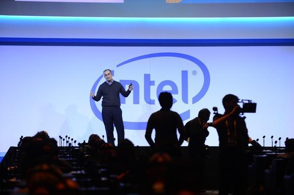 Intel CEO Brian Krzanich on stage with a large Intel logo behind him.