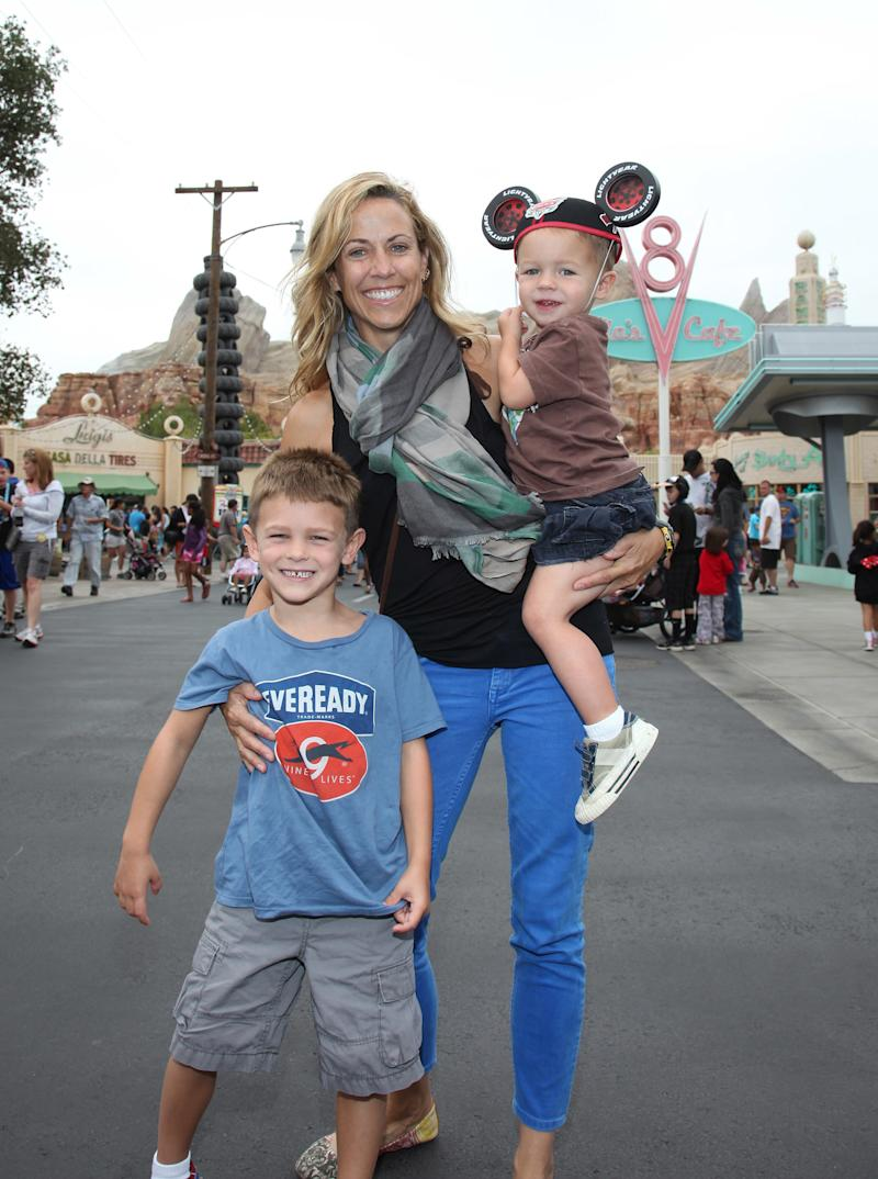 """In 2012, Crow took her sons to Disney California Adventure. In April, she said adopting them was """"the biggest everlasting event that has informed everything."""" (Handout via Getty Images)"""