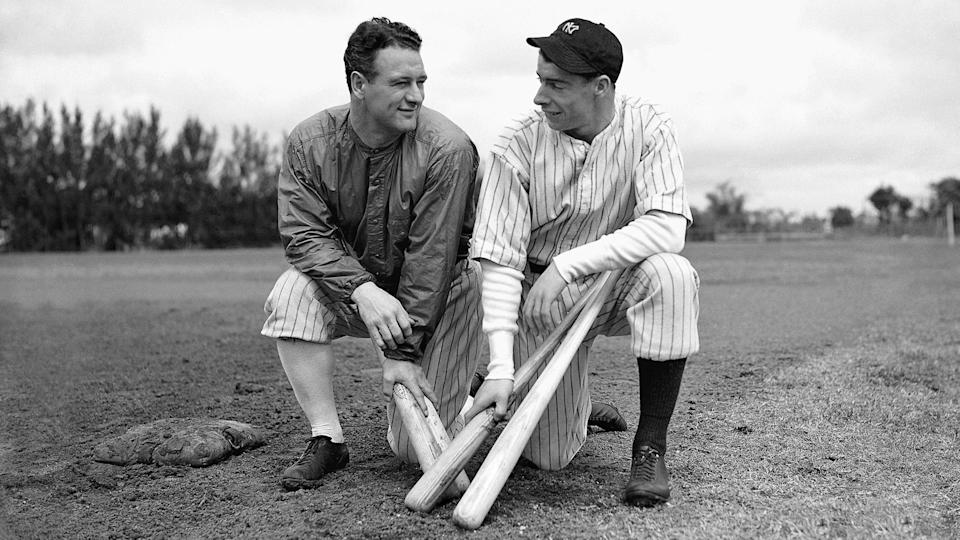Mandatory Credit: Photo by AP/Shutterstock (6673608a)Lou Gehrig; Joe DiMaggio Lou Gehrig, left, gets something like a smile from rookie sensation Joe DiMaggio during spring training in St.