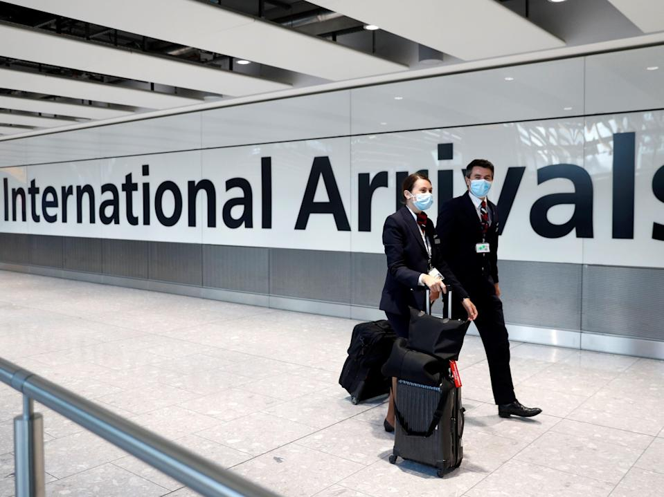 <p>Business travellers could be exempt from quarantine under new government plans</p> (AFP via Getty Images)
