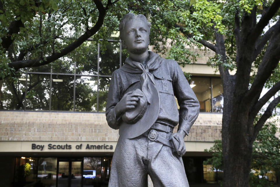 FILE - In this Feb. 12, 2020 file photo, a statue stands outside the Boys Scouts of America headquarters in Irving, Texas. Close to 90,000 sex-abuse claims have been filed against the Boy Scouts of America as the deadline arrived Monday, Nov. 16 for filing claims in the BSA's bankruptcy case. The number far exceeded initial projections of lawyers across the United States who have been signing up clients in the case since the Boy Scouts filed for bankruptcy protection in February in the face of hundreds of lawsuits. (AP Photo/LM Otero, File)