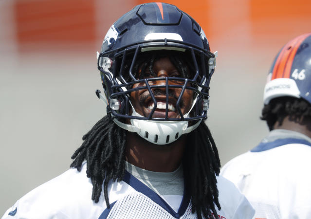 Denver Broncos linebacker Von Miller smiles as he wears fake dreadlocks while taking part in drills at the NFL football team's training camp Thursday, June 14, 2018, in Englewood, Colo. (AP Photo/David Zalubowski)