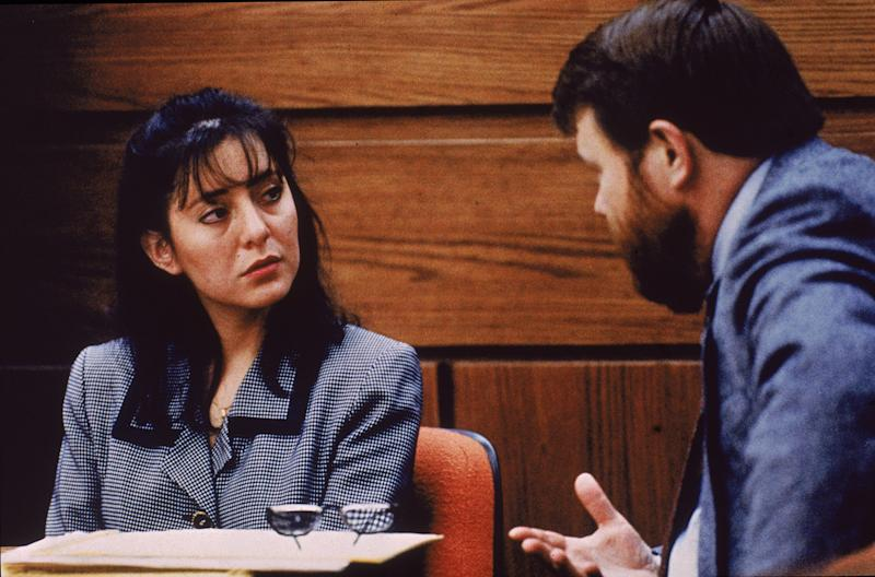 Lorena Bobbitt listens to a lawyer during her trial, Manassas, Virginia, January 1994. Bobbitt was on trial for cutting off her husband's penis; she was acquitted by reason of temporary insanity. | Consolidated News Pictures—Getty Images