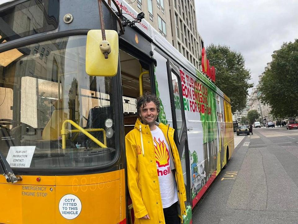 Darren Cullen, the artist who created the mural on the bus, poses outside of the Shell offices. (Isobel Frodsham/PA) (PA)
