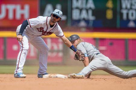 Jun 17, 2018; Atlanta, GA, USA; San Diego Padres left fielder Travis Jankowski (16) is tagged out by Atlanta Braves shortstop Dansby Swanson (7) after his foot came off the base on a steal attempt during the sixth inning at SunTrust Park. Mandatory Credit: Dale Zanine-USA TODAY Sports