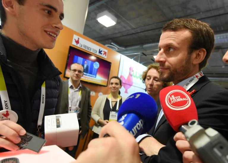French presidential candidate and former economy minister Emmanuel Macron (R) has come under scrutiny for a trip to the Consumer Electronics Show in Las Vegas, pictured here in January 2017