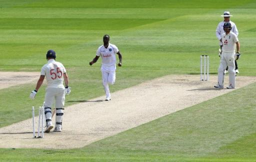Kemar Roach (C) dismissed England's Ben Stokes (L) during a return of 4-72 that included the West Indies fast bowler's 200th Test wicket