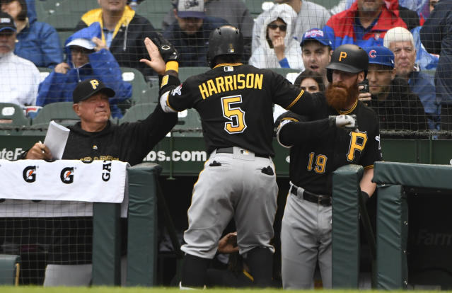 Pittsburgh Pirates' Josh Harrison (5) high-fives manager Clint Hurdle, left, and Colin Moran (19) after hitting a home run during the first inning of a baseball game against the Chicago Cubs, Sunday, June 10, 2018, in Chicago. (AP Photo/Matt Marton)