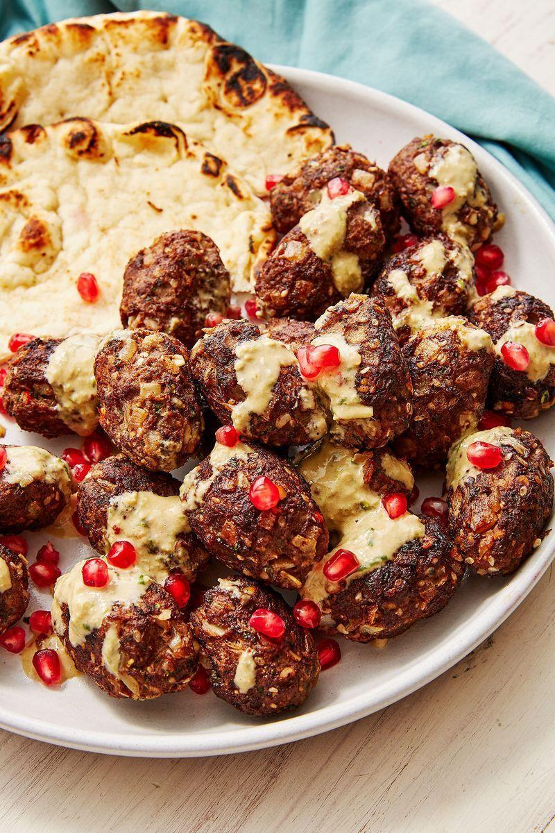 """<p>Koftas are SUCH a great dinner choice, as they're easy to make, but look seriously fancy. We love using a mixture of minced lamb and beef and serving these with a tahini dressing, flatbreads and pomegranate seeds.</p><p>Get the <a href=""""https://www.delish.com/uk/cooking/recipes/a29725444/lamb-kofta/"""" rel=""""nofollow noopener"""" target=""""_blank"""" data-ylk=""""slk:Lamb Koftas"""" class=""""link rapid-noclick-resp"""">Lamb Koftas</a> recipe.</p>"""