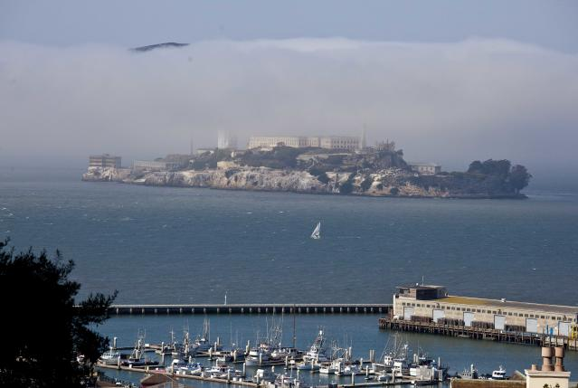 """In this photo taken Thursday, Sept. 27, 2012, a sailboat makes its way past Alcatraz Island in San Francisco. San Francisco has a long history as a favorite site for filmmakers and the movie buffs who want to see the spots where their favorite scenes took place, from Fort Point under the Golden Gate Bridge where Jimmy Stewart saved Kim Novak in """"Vertigo"""" to the steps of City Hall, where Sean Penn gave an impassioned speech in """"Milk,"""" to Alcatraz, stage for Clint Eastwood and many others. (AP Photo/Eric Risberg)"""