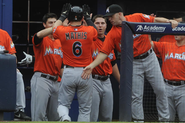 Miami Marlins' Jeff Mathis (6) is congratulated in the dugout after his home run against the Atlanta Braves during the second inning of a baseball game on Sunday, Sept. 1, 2013, in Atlanta. (AP Photo/John Amis)