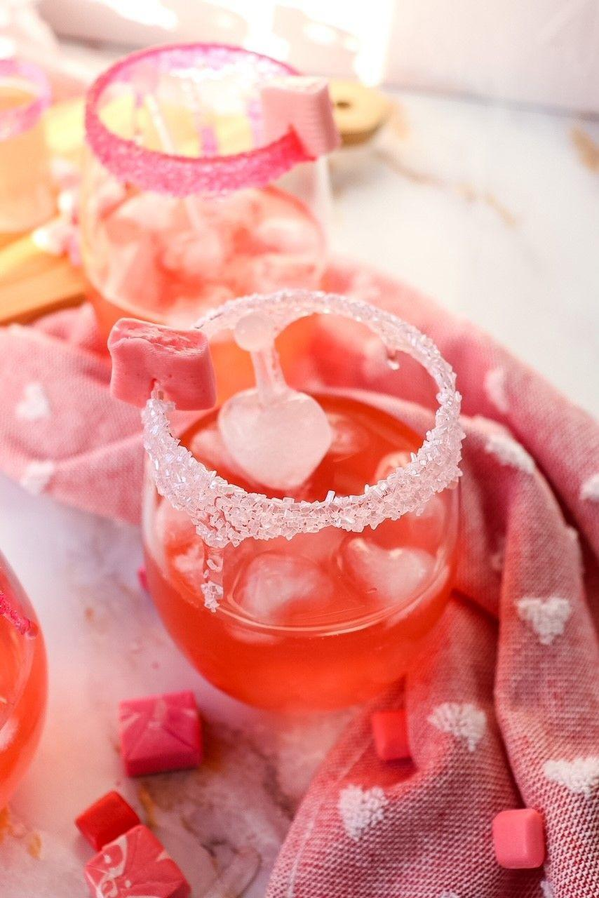 """<p>Yes, you read that right. You can now enjoy the drink version of your favorite Halloween candy with this pink Starburst punch. </p><p><strong>Get the recipe at <a href=""""https://www.razzledazzlelife.com/pink-starburst/"""" rel=""""nofollow noopener"""" target=""""_blank"""" data-ylk=""""slk:Razzle Dazzle Life"""" class=""""link rapid-noclick-resp"""">Razzle Dazzle Life</a>.</strong></p><p><strong><a class=""""link rapid-noclick-resp"""" href=""""https://www.amazon.com/Cy3Lf-Silicone-Heart-Shape-Chocolate/dp/B0193ANZPY/?tag=syn-yahoo-20&ascsubtag=%5Bartid%7C2164.g.36792938%5Bsrc%7Cyahoo-us"""" rel=""""nofollow noopener"""" target=""""_blank"""" data-ylk=""""slk:SHOP HEART ICE CUBE TRAYS"""">SHOP HEART ICE CUBE TRAYS</a></strong></p>"""