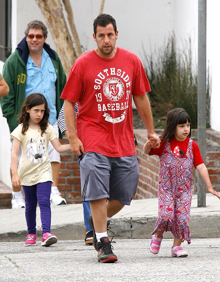 Adam Sandler accompanied raven-haired daugthers, 7-year-old Sadie (left) and 4-year-old Sunny to dinner on Saturday evening in Los Angeles, but from the look on her face Sadie might have preferred to stay home! (5/4/2013)