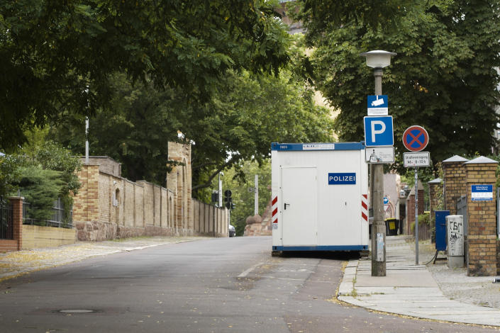 FILE - In this Monday, July 20, 2020 file photo, a container used by police is seen in front of the synagogue in Halle, Germany where a gunman made an attack on Yom Kippur 2019. Millions have be provided to enhance the security of Jewish sites, but some say it is still not enough and also doesn't tackle the question whether Jewish life can ever be normal and safe in Germany. (AP Photo/Markus Schreiber)