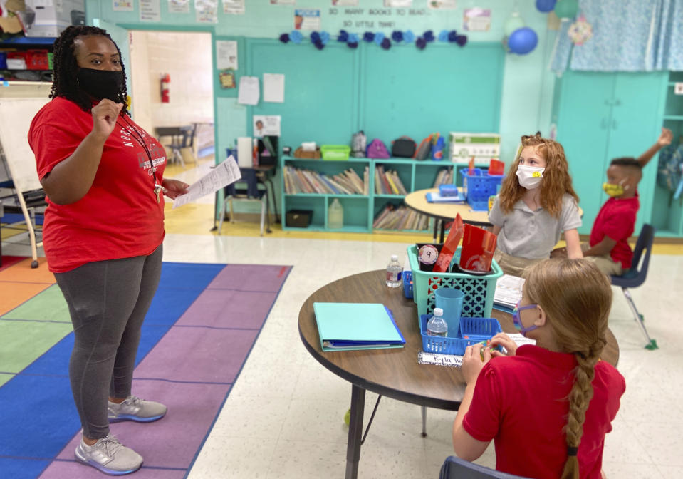 Fourth grade teacher Krileshia Boyd speaks to her students at Northeast Lauderdale Elementary School in Lauderdale County, Miss., Monday, Aug. 10, 2020. Schools are reopening this week under new guidelines after being closed in March as the COVID-19 pandemic spread. School staff and students are both required to wear masks under an order signed by Gov. Tate Reeves last week. (Bill Graham/The Meridian Star via AP)