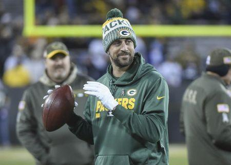 Nov 6, 2017; Green Bay, WI, USA; Green Bay Packers quarterback Aaron Rodgers (12) plays with a football prior to the game against the Detroit Lions at Lambeau Field. Mandatory Credit: Benny Sieu-USA TODAY Sports