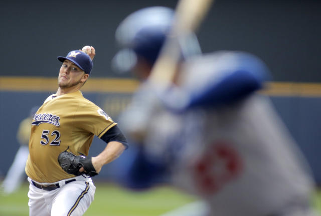 Milwaukee Brewers pitcher Jimmy Nelson delivers to the Los Angeles Dodgers during the first inning of a baseball game Sunday, Aug. 10, 2014, in Milwaukee. (AP Photo/Darren Hauck)