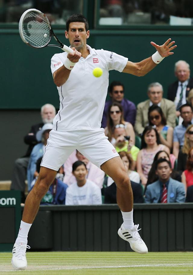 Novak Djokovic of Serbia plays a return to Roger Federer of Switzerland during their men's singles final match at the All England Lawn Tennis Championships in Wimbledon, London, Sunday, July 6, 2014. (AP Photo/Ben Curtis)