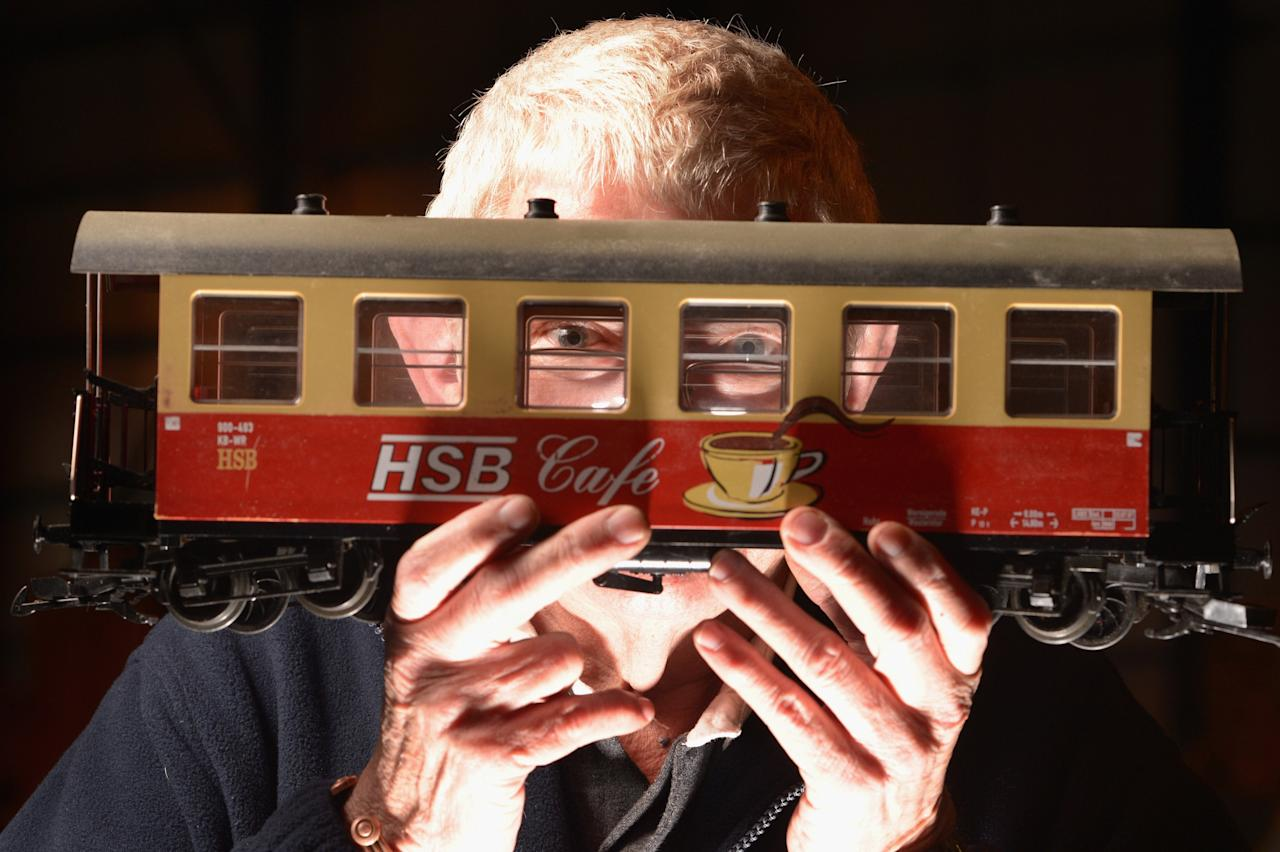 GLASGOW, SCOTLAND - FEBRUARY 21:  Donal Weymss holds a G scale carriage as model enthusiasts gather for the Model Rail Scotland exhibition on February 21, 2013 in Glasgow, Scotland. Model railway clubs from all corners of the UK and parts of Europe will be displaying over 50 model railway layouts at this year's event held at The Scottish Exhibition Centre in Glasgow from February 22nd to the 24th.  (Photo by Jeff J Mitchell/Getty Images)